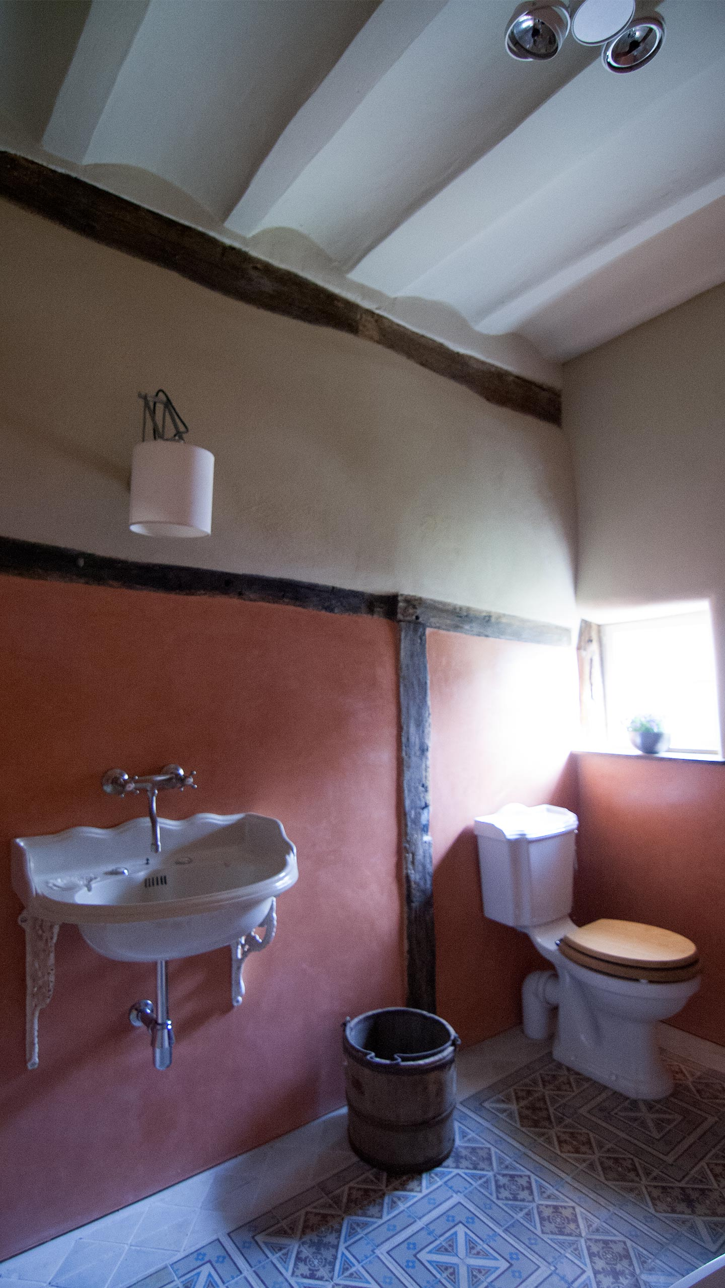 Residential - Coral red bathroom, Toilet and sink
